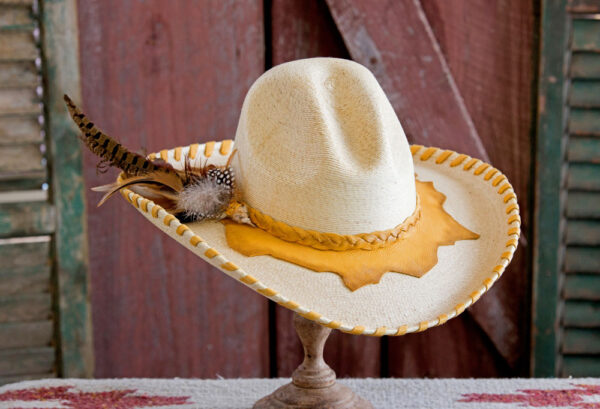 white cowboy hat with gold leather band