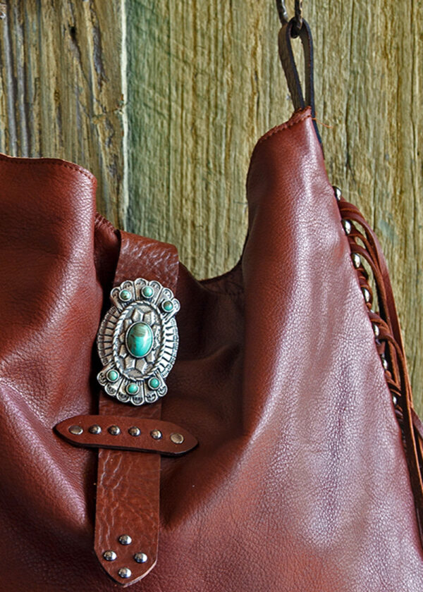 red river cowhide bag close up