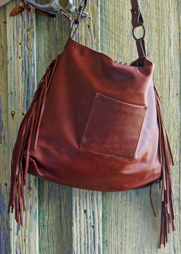 red river cowhide bag back view